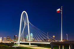 Margaret Hunt Hill Bridge over the Trinity River and Texas Flag, Dallas, Texas, USA.