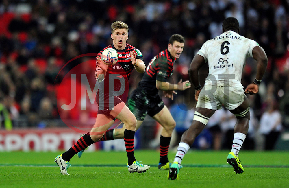 Saracens fly half Owen Farrell looks to catch the ball - Photo mandatory by-line: Patrick Khachfe/JMP - Tel: 07966 386802 - 18/10/2013 - SPORT - RUGBY UNION - Wembley Stadium, London - Saracens v Toulouse - Heineken Cup Round 2.