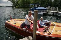 "Steve Clark and mother Ruth bring their 19' 1949 Century ""Maiden '49"" into dock at Cow Island, Lake Winnipesaukee, New Hampshire.  ©2018 Karen Bobotas Photographer"
