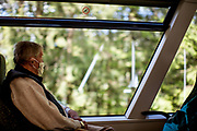 An elderly man with a face mask is travelling in Bavaria with a local train towards the city of Bayerisch Einsenstein close to the Czech border after the corona virus outbreak changed our public lifes.
