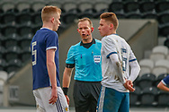 The Referee steps in as Liam Morrison (Celtic FC) & Igor Vorobyev exchange words during the U17 European Championships match between Scotland and Russia at Simple Digital Arena, Paisley, Scotland on 23 March 2019.