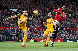Manchester United's Paul Pogba (right) flinches as Brighton & Hove Albion's Shane Duffy intercepts the ball during the Premier League match at Old Trafford, Manchester.
