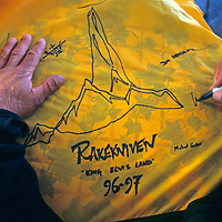 ANTARCTICA, Queen Maud Land Expedition.  Team member signs tent for Twin Otter Pilot.