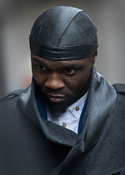 © Licensed to London News Pictures. 12/12/2016. London, UK. Efe Sodje arrives at the Old Bailey. Former Premier League player Sam Sodje and three of his brothers have been charged with fraudulent trading in connection with their Sodje Sports Foundation charity. Photo credit: Peter Macdiarmid/LNP