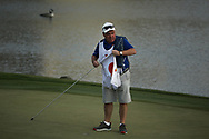 Tyrrell Hatton (ENG) caddy Michael Donaghy collecting the 18th flag pin during the final round of the Arnold Palmer Invitational presented by Mastercard, Bay Hill, Orlando, Florida, USA. 08/03/2020.<br /> Picture: Golffile   Scott Halleran<br /> <br /> <br /> All photo usage must carry mandatory copyright credit (© Golffile   Scott Halleran)