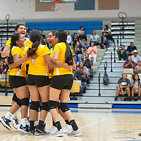 The Zuni Thunderbirds volleyball team comes together on the court to celebrate after scoring their final point in the fifth set to beat the Navajo Pine Warriors Thursday night in Zuni. Zuni won three straight sets to come back and win the match 3-2.