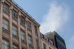 London, UK. 6 June, 2019. Smoke appears above a roof as London Fire Brigade attends to a fire at Gymkhana, a Michelin-starred Indian restaurant in Mayfair, with at least eight fire engines and 60 firefighters. London Fire Brigade reported that half of the ground floor kitchen and half of the ducting from ground floor to roof level is alight. Fire crews attended from Soho, Lambeth, Kensington, Euston, Paddington, Chelsea and Dowgate.