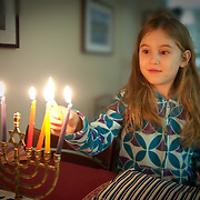 Lighting candles on the last, eighth night of Chanukah, the Jewish Festival of Lights