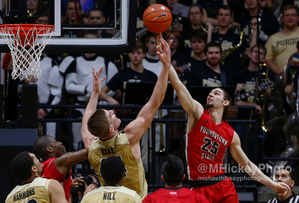 WEST LAFAYETTE, IN - DECEMBER 12: Isaac Haas #44 of the Purdue Boilermakers and Jordan Andrews #25 of the Youngstown State Penguins reach for the ball at Mackey Arena on December 12, 2015 in West Lafayette, Indiana. Purdue defeated Youngstown State 95-64. (Photo by Michael Hickey/Getty Images) *** Local Caption *** Isaac Haas; Jordan Andrews