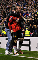 Ibrox Park Glasgow Rangers v Manchester United (0-1) Champions League Group  C  24/11/2010<br /> Wayne Rooney (Man Utd)  is grabbed by a fan as  celebrates  after scoring  winner from penalty<br /> Photo: Roger Parker Fotosports International
