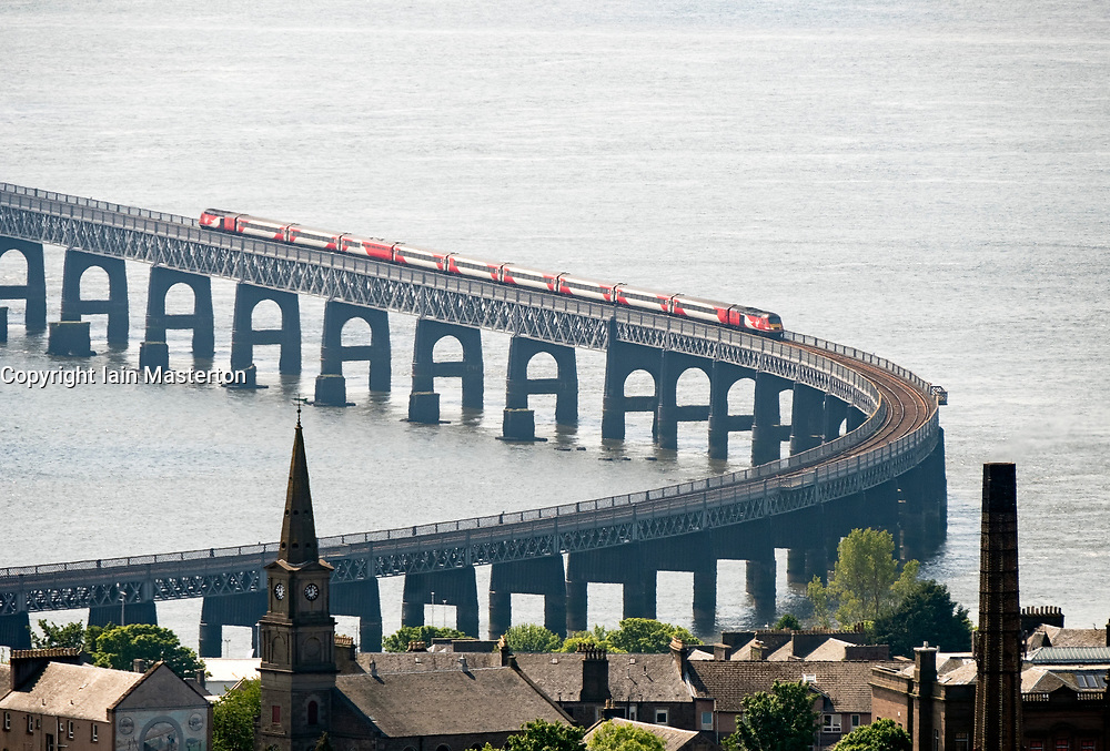 East Coast Main Line train by Virgin crossing Tay Railway Bridge spanning the River Tay in Dundee, Tayside, Scotland, UK