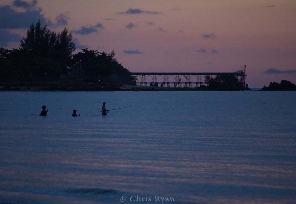 Fishermen at dusk, Phang Nga Bay/Andaman Sea, Thailand.