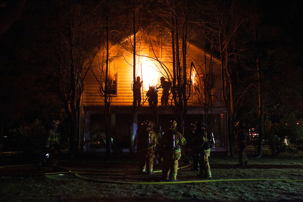 Sherborn, MA 04/11/2013<br /> Firefighters evacuate the 2nd floor of a house at 255 Western Ave. in Sherborn while fighting a 3 alarm fire on Thursday night.<br /> Alex Jones / www.alexjonesphoto.com