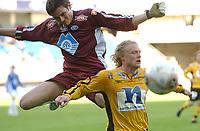 Fotball eliteserien 17.04.05 Molde - Start 0-1<br /> Lars Ivar Moldskred og Jon Mittun Lie<br /> Foto: Carl-Erik Eriksson, Digitalsport