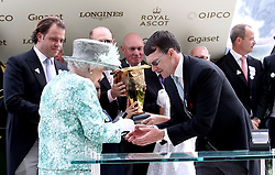 Queen Elizabeth II presents a medal to trainer Aiden O'Brien after Merchant Navy wins the Diamond Jubilee Stakes during day five of Royal Ascot at Ascot Racecourse.