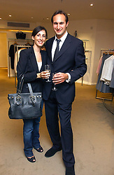 MITCH TILLMAN and NICOLE FRANKEL  at an exhibition of photographs entitled 'Hispanic in Hollywood' at Jaeger's Flagship store 200 Regent Street, London on 30th August 2006.<br /><br />NON EXCLUSIVE - WORLD RIGHTS