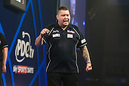 Michael Smith celebrates winning his second round match against Mervyn King during the William Hill World Darts Championship at Alexandra Palace, London, United Kingdom on 23 December 2016. Photo by Shane Healey.