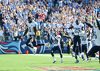 Tennessee Titans Bernard Pollard and other teammates jump for joy as the Titans beat the San Diego Chargers on a last second touchdown at LP Field on September 22, 2013 in Nashville, TN. Photos by Donn Jones Photography.