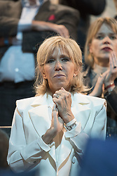 The wife of French presidential election candidate for the En Marche ! movement Emmanuel Macron, Brigitte Trogneux gestures during a campaign meeting on April 17, 2017 at the Bercy Arena in Paris. Macron plans his biggest rally yet at the Bercy sports and concert hall, a venue with a capacity of 20,000. The location near the economy ministry serves as a reminder that the relatively inexperienced Macron held the key economy portfolio for two years under his mentor Hollande. Photo by ABACAPRESS.COM  | 589639_014 PAris France