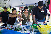 Lots of food was shared between customers and employees during a Nob Hill Foods farewell BBQ at Strickroth Park in Milpitas, California, on May 15, 2016. (Stan Olszewski/SOSKIphoto)