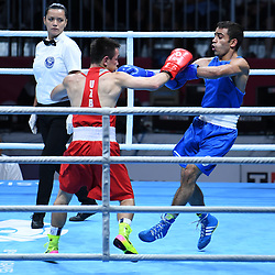 JAKARTA, Sept. 1, 2018  Amit (R) of India competes during Men's Light Fly (49kg) Final of Boxing against Hasanboy Dusmatov of Uzbekistan at the 18th Asian Games in Jakarta, Indonesia, Sept. 1, 2018. (Credit Image: © Pan Yulong/Xinhua via ZUMA Wire)