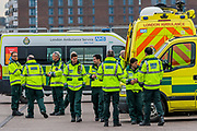 Ambulances are prepared for shifts and crews are given assignments from a control van, although not all practice social distancing - the new Nightingale Hospital at the Excel Centre -  The 'lockdown' continues for the Coronavirus (Covid 19) outbreak in London.