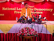"""05 NOVEMBER 2015 - YANGON, MYANMAR: A NLD official stands at the microphones before a press conference with Aung San Suu Kyi. During the press conference, which lasted 90 minutes, Aung San Suu Kyi, the leader of the National League for Democracy (NLD), said that if the NLD won the election she would serve """"above"""" the President. When questioned about the Rohingya crisis in western Myanmar, a reporter called the situation """"dramatic"""" and Suu Kyi replied the entire country is in a """"dramatic situation"""" and the problems of the Rohingya should not be """"exaggerated."""" She said the """"great majority of our people remain as poor as ever."""" She also said the NLD would make a """"fuss"""" if election results were """"suspicious."""" Citizens of Myanmar go to the polls Sunday November 8 in what is widely viewed as the most democratic and contested election in Myanmar's history. The NLD is widely expected to win the election.   PHOTO BY JACK KURTZ"""
