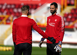 Aberdeen goalkeeper Gary Woods (left) and Joe Lewis warming up prior to kick-off during the cinch Premiership match at Pittodrie Stadium, Aberdeen. Picture date: Sunday October 3, 2021.