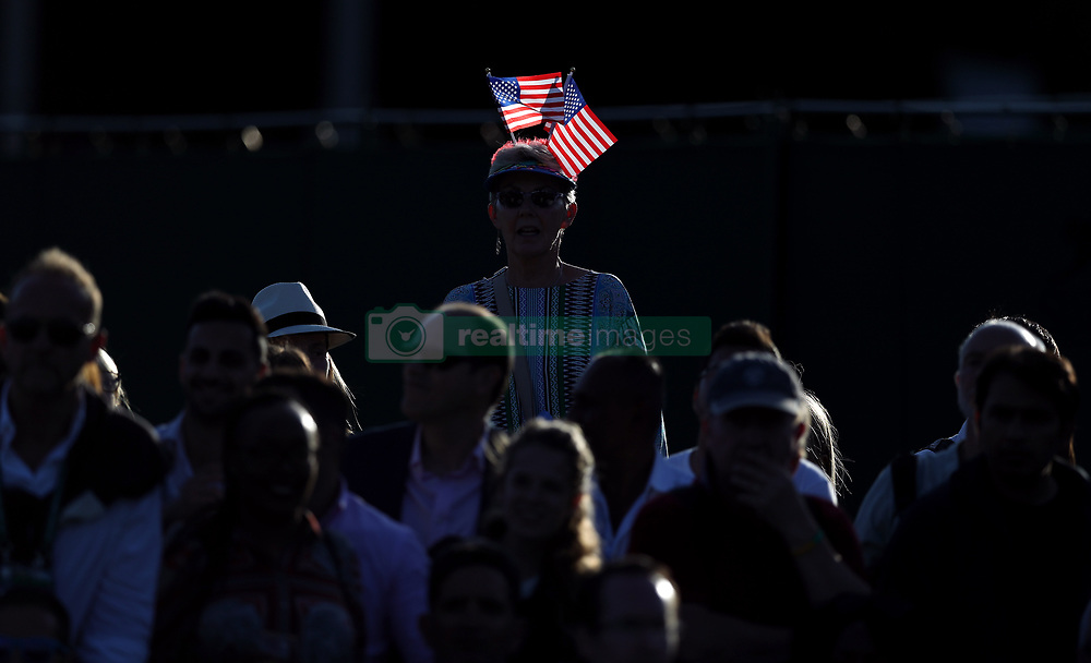 A spectator wearing flags of the United States of America on her hat on American Independence day on day two of the Wimbledon Championships at The All England Lawn Tennis and Croquet Club, Wimbledon.