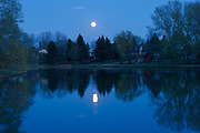 Moon rising over pond. Southdale neighbourhood. <br />