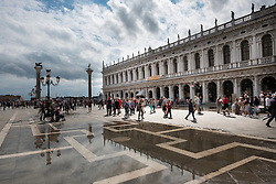 Architecture reflected in flood water, Piazza San Marco, Venice, Italy.<br />