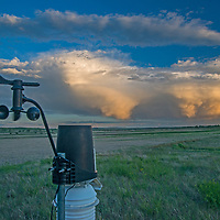 An anemometer records wind speeds as a thunderstorm rolls over the American Prairie Reserve in Phillips County, Montana.