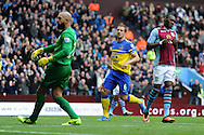 Christian Benteke ® reacts after his penalty is saved by Everton goalkeeper Tim Howard (l). Barclays Premier League, Aston Villa v Everton at Villa Park in Aston, Birmingham on Saturday 26th Oct 2013. pic by Andrew Orchard, Andrew Orchard sports photography,