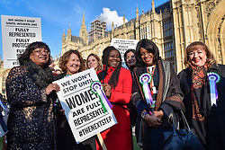 © Licensed to London News Pictures. 06/02/2018. LONDON, UK.  (Left) Diane Abbott joins female members of the Shadow Cabinet and Labour politicians outside the Houses of Parliament, wearing Labour styled suffragette rosettes, holding placards next to a '100 Years of Women Voting' banner to help launch Labour's campaign to celebrate 100 years of women's suffrage.    Photo credit: Stephen Chung/LNP