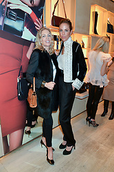 Left to right, PRISCILLA WATERS and VANESSA ARELLE at the Roger Vivier 'The Perfect Pair' Frieze cocktail party celebrating Ambra Medda & 'Miss Viv' at the Roger Vivier Boutique, Sloane Street, London on 15th October 2014.