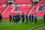 Chertsey Town players inspect the pitch ahead of the FA Vase final match between Chertsey Town and Cray Valley at Wembley Stadium, London, England on 19 May 2019.