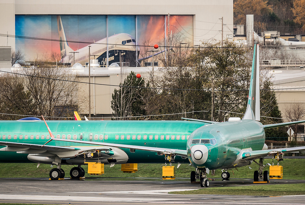 Boeing 737 airplanes outside the Boeing Renton Assembly Plant in Renton, Washington, 11/29/2018.  Mural above covers a factory building door.