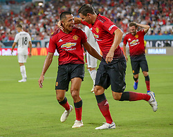 July 31, 2018 - Miami Gardens, FL, USA - Manchester United forward Alexis Sanchez (7) celebrates with teammate Matteo Darmian (36) after scoring in the first half against Real Madrid during International Champions Cup action at Hard Rock Stadium in Miami Gardens, Fla., on Tuesday, July 31, 2018. Manchester United won, 2-1. (Credit Image: © Al Diaz/TNS via ZUMA Wire)