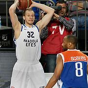 Anadolu Efes's Sinan Guler (L) during their Turkish Basketball League match Anadolu Efes between Mersin BSB at Sinan Erdem Arena in Istanbul, Turkey, Saturday, January 14, 2012. Photo by TURKPIX