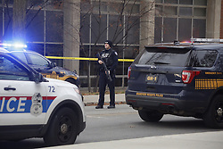 November 28, 2016 - USA - Officers search the area near Watts Hall Monday, Nov. 28, 2016 during reports of an active shooter on Ohio State's campus in Columbus, Ohio. Law enforcement sources say nine people have been transported to hospitals and a suspect has been killed. (Credit Image: © Tom Dodge/TNS via ZUMA Wire)