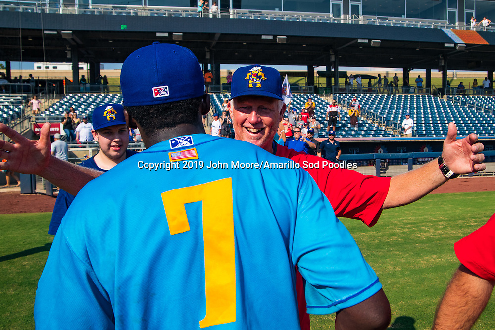 Amarillo Sod Poodles outfielder Taylor Trammell (7) and Amarillo Sod Poodles pitching coach Jimmy Jones celebrates after the Sod Poodles won against the Tulsa Drillers during the Texas League Championship on Sunday, Sept. 15, 2019, at OneOK Field in Tulsa, Oklahoma. [Photo by John Moore/Amarillo Sod Poodles]