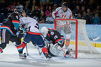 KELOWNA, CANADA - OCTOBER 16: Jordon Cooke #30 of the Kelowna Rockets keeps his eye on the puck as he defends the net against the Lethbridge Hurricanes on October 16, 2013 at Prospera Place in Kelowna, British Columbia, Canada.   (Photo by Marissa Baecker/Shoot the Breeze)  ***  Local Caption  ***