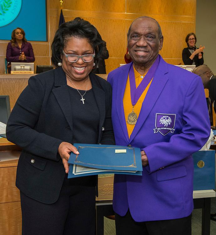 Houston ISD Board of Trustees member Paula Harris recognizes former Jones High School football coach James Humphery during the Board of Trustees meeting, February 12, 2015.