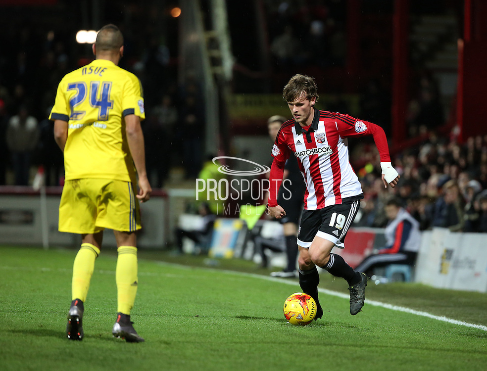 Brentford midfielder John Swift taking on Middlesbrough midfielder Emilio Nsue during the Sky Bet Championship match between Brentford and Middlesbrough at Griffin Park, London, England on 12 January 2016. Photo by Matthew Redman.