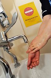 Nurse washing her hands in community hospital Bradford UK