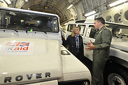 © Licensed to London News Pictures. 15 Nov 2013. RAF Brize Norton. First Typhoon relief aid flight to depart from the UK. Secretary of State Justine Greening MP visits the C17 Aircraft and is shown around by Group Captain Steve Lushington. Photo credit : MarkHemsworth/LNP