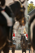 Royal Guards in red uniforms on horses, London, England, UK