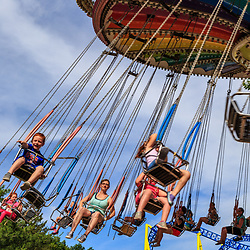 Elysburg, PA – June 22, 2016: Riders enjoy the swing ride at Knoebels Amusement Resort, America's largest free-admission park.