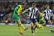 Johan Elmander (l) of Norwich city has a shot at goal. Barclays Premier league, West Bromwich Albion v Norwich city at the Hawthorns in West Bromwich, England on Sat 7th Dec 2013. pic by Andrew Orchard, Andrew Orchard sports photography.