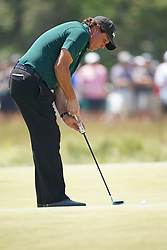June 16, 2018 - Southampton, NY, USA - Phil Mickelson putting on the 8th green during the third round of the 2018 U.S. Open at Shinnecock Hills Country Club in Southampton, N.Y., on Saturday, June 16, 2018. (Credit Image: © Brian Ciancio/TNS via ZUMA Wire)
